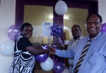 ABG Deputy Speaker, Francesca Semoso(left) and ANG General Manager, Customers & Markets, Dominic Kaumu cutting the ribbon to mark the opening of the new office.